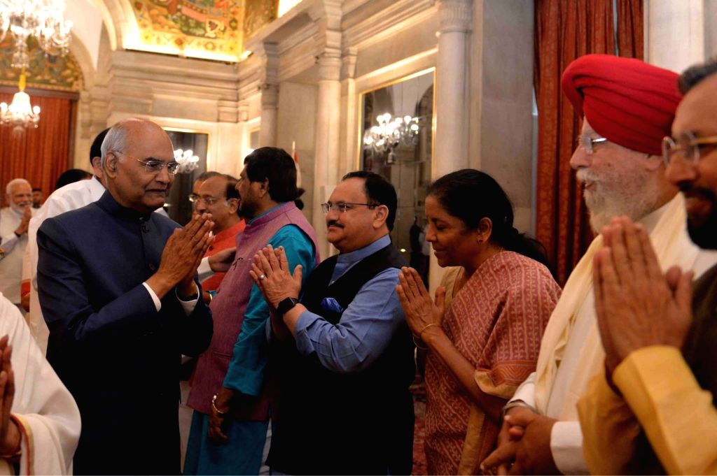 Union Ministers Ramdas Athawale, J.P Nadda, Nirmala Sitharaman, S.S. Ahluwalia and Prakash Javadekar greet President Ram Nath Kovind during a banquet hosted by the latter for the outgoing ... - Narendra Modi, Ramdas Athawale, J. and Nath Kovind