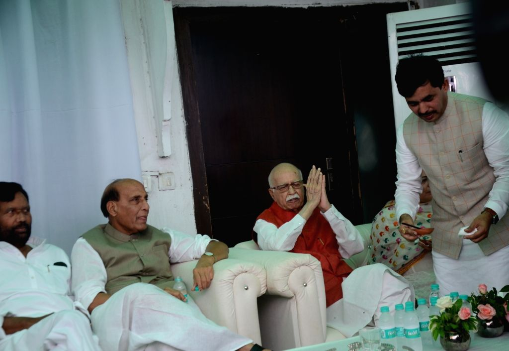 Union Ministers Ramvilas Paswan and Rajnath Singh with BJP veteran LK Advani during a party hosted by BJP leader Shahnawaz Hussain on Eid-ul-Fitr in New Delhi on June 5, 2019. - Ramvilas Paswan and Rajnath Singh