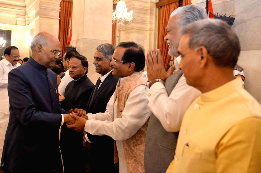Union Ministers Shripad Yesso Naik, Parshottam Rupala and Satya Pal Singh greet President Ram Nath Kovind during a banquet hosted by the latter for the outgoing Union Council of Ministers ... - Narendra Modi, Shripad Yesso Naik, Parshottam Rupala, Satya Pal Singh and Nath Kovind