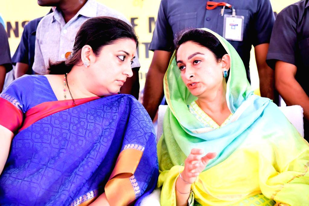 Union Ministers Smriti Irani and Harshimrat Kaur Badal during foundation stone laying ceremony of IIM in Manawala near Amritsar on June 19, 2016. - Ministers Smriti Irani and Harshimrat Kaur Badal