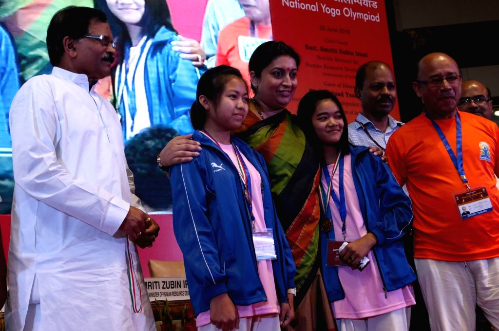 Union Ministers Smriti Irani and Shripad Yasso Naik during National Yoga Olympiad - award ceremony in New Delhi, on June 20, 2016. - Ministers Smriti Irani and Shripad Yasso Naik