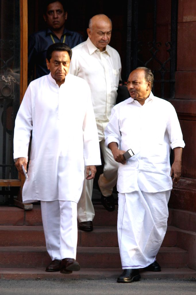Union Ministers Sushilkumar Shinde, Kamal Nath and AK Antony come out after the last cabinet meeting of UPA-II government in New Delhi on May 13, 2014. - Sushilkumar Shinde and Kamal Nath