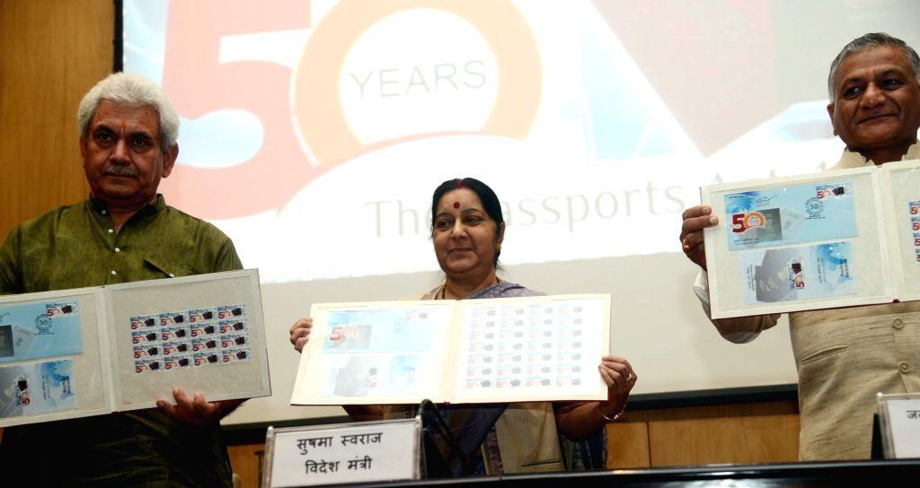 Union Ministers Sushma Swaraj, Manoj Sinha and General (Retd.) VK Singh unveil a stamp on Passport Seva Divas in New Delhi, on June 23, 2017. - Sushma Swaraj, Manoj Sinha and General