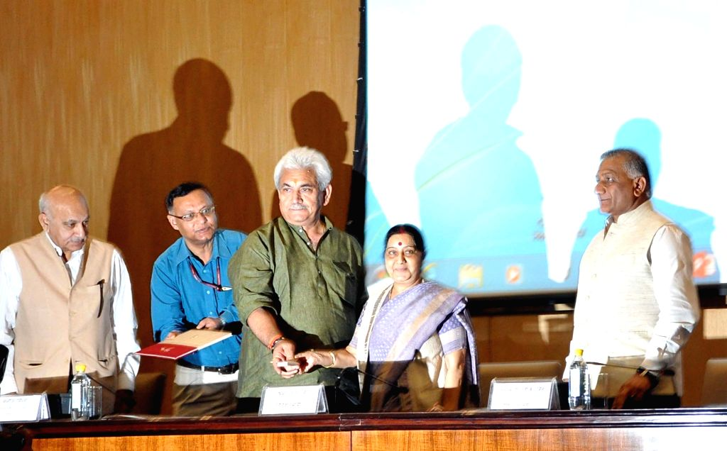 Union Ministers Sushma Swaraj, Manoj Sinha, MJ Akbar and General (Retd.) VK Singh unveil a stamp on Passport Seva Divas in New Delhi, on June 23, 2017. - Sushma Swaraj and Manoj Sinha