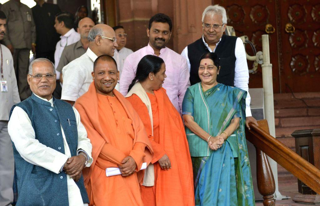 Union Ministers Uma Bharti, Sushma Swaraj and BJP MP Yogi Adityanath at Parliament in New Delhi on Feb 15, 2017. - Uma Bharti and Sushma Swaraj