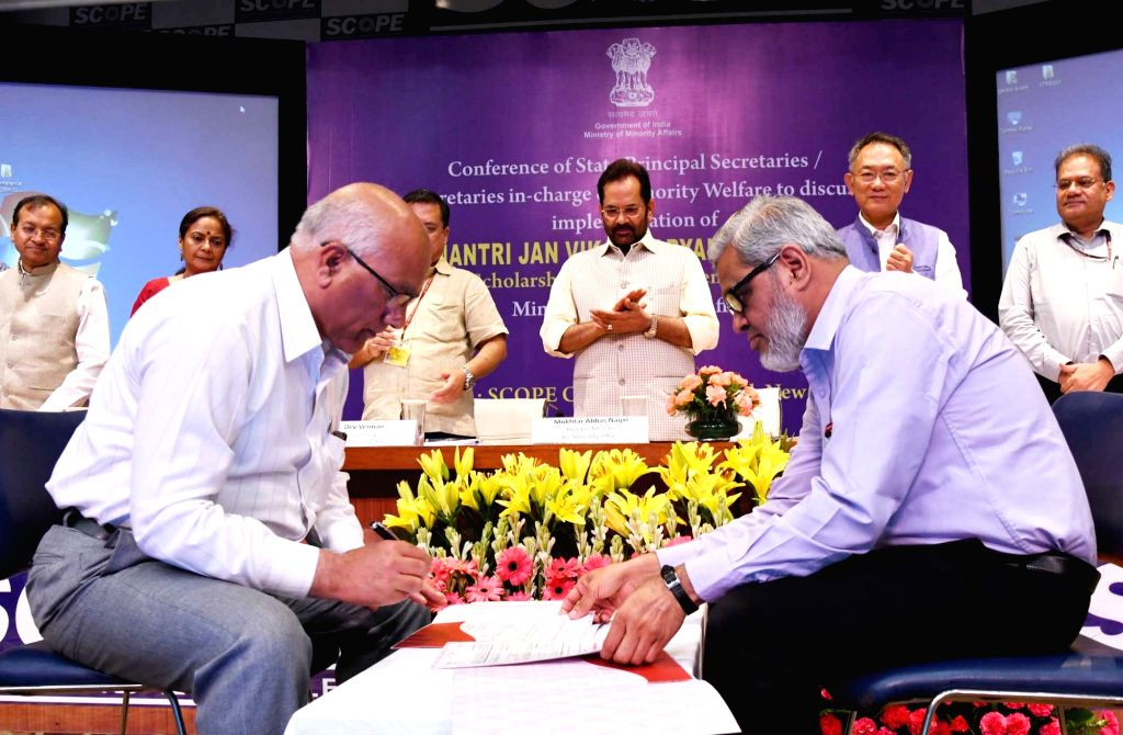 Union Minority Affairs Minister Mukhtar Abbas Naqvi and Ministry of Minority Affairs Secretary Ameising Luikham witness the signing of MoUs at National Conference of Principal Secretaries/ ... - Mukhtar Abbas Naqvi