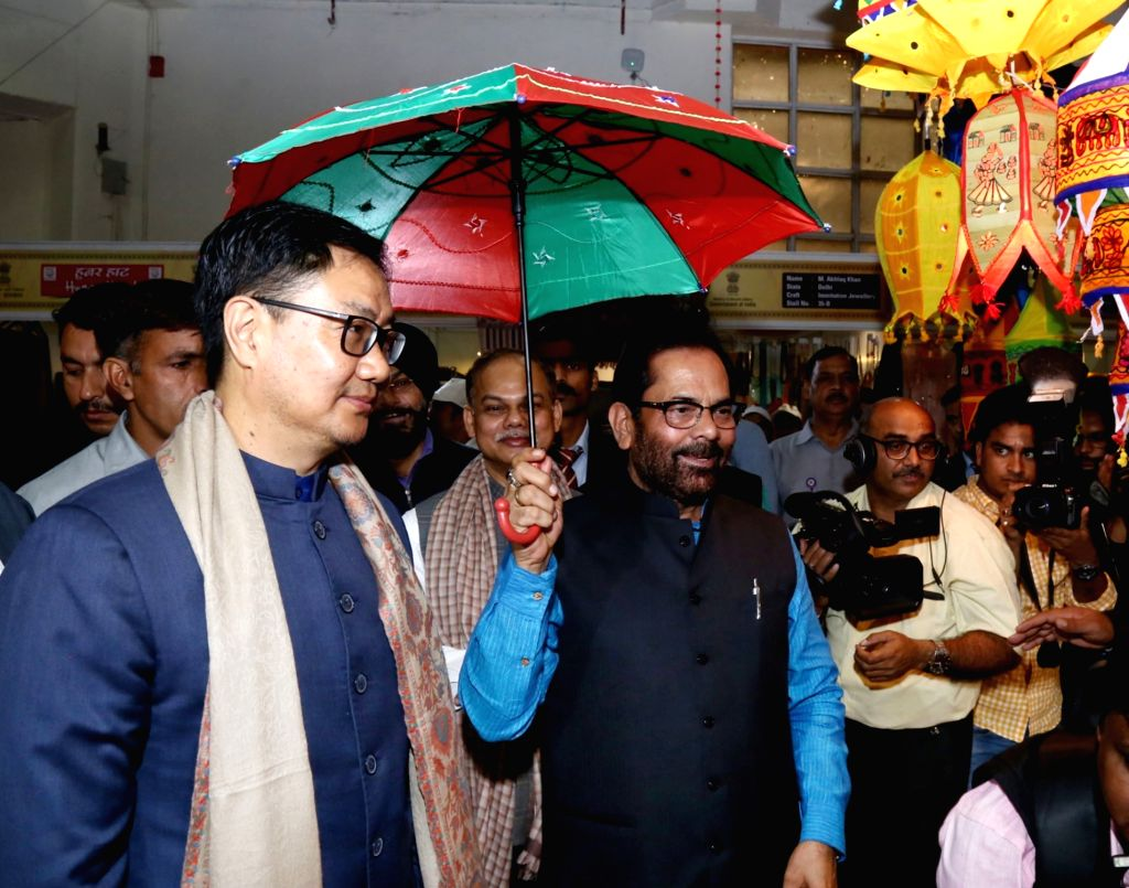 Union Minority Affairs Mukhtar Abbas Naqvi and Union MoS Youth Affairs and Sports (Independent Charge) and Minority Affairs Kiren Rijiju visit Hunar Haat after inaugurating it, at the 39th ...