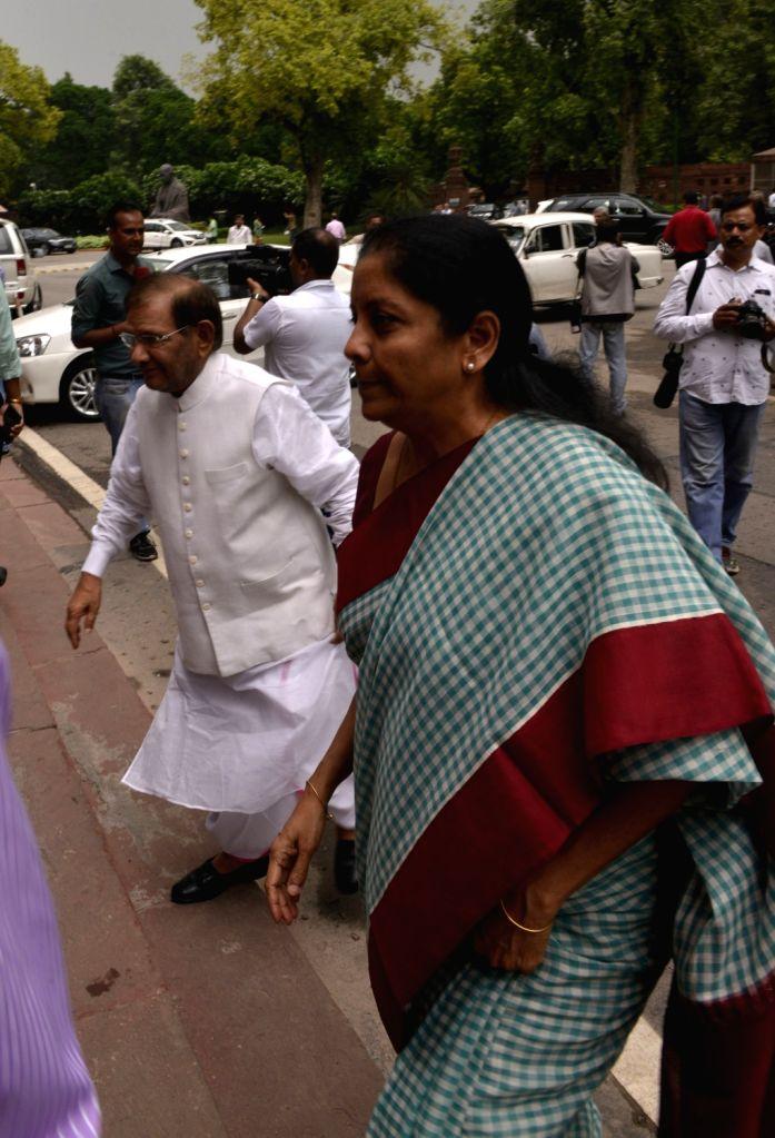 Union MoS Commerce and Industry Nirmala Sitharaman along with Rajya Sabha member Sharad Yadav at Parliament in New Delhi on Aug 9, 2017. - Sharad Yadav