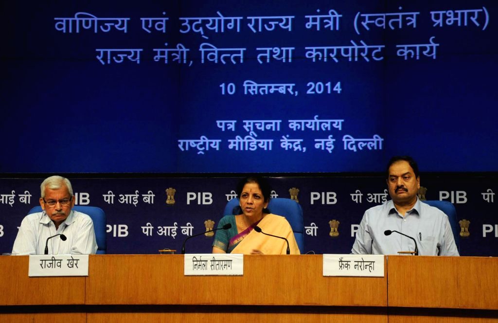 Union MoS Commerce & Industry (Independent Charge), Finance and Corporate Affairs Nirmala Sitharaman during a press conference in New Delhi on September 10, 2014. Also seen Director General ...
