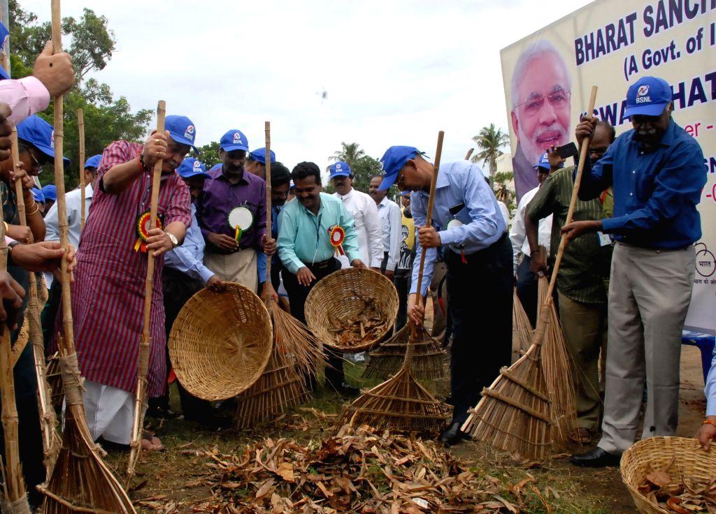 Union MoS Communications (I/C) and Railways Manoj Sinha clears the garbage as part of 'Swachhta Hi Sewa' campaign at Rajiv Gandhi Telecom Training Centre (RTTC) in Chennai on Sept 17, 2017. - Manoj Sinha