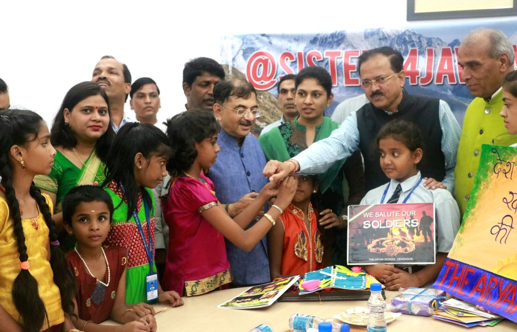 Union MoS Defence Subhash Bhamre getting a rakhee tied during a programme to celeberate Raksha Bandhan in New Delhi on Aug 2, 2017.