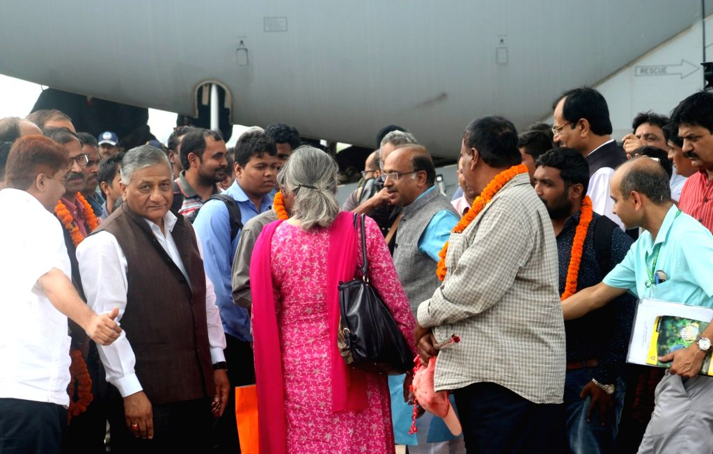 Union MoS External Affairs Gen (retd) VK Singh arrives at Palam Airport along with the Indians evacuated from violence hit South Sudan; in New Delhi, on July 15, 2016. The evacuation was ... - K. Singh