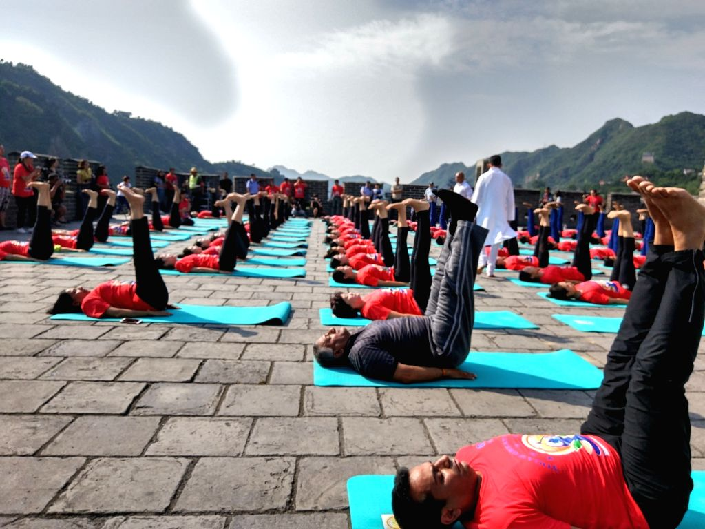 Union MoS External Affairs Gen (Retd.) VK Singh performs yoga on the Great Wall of China on the eve of International Yoga Day, on June 20, 2017.