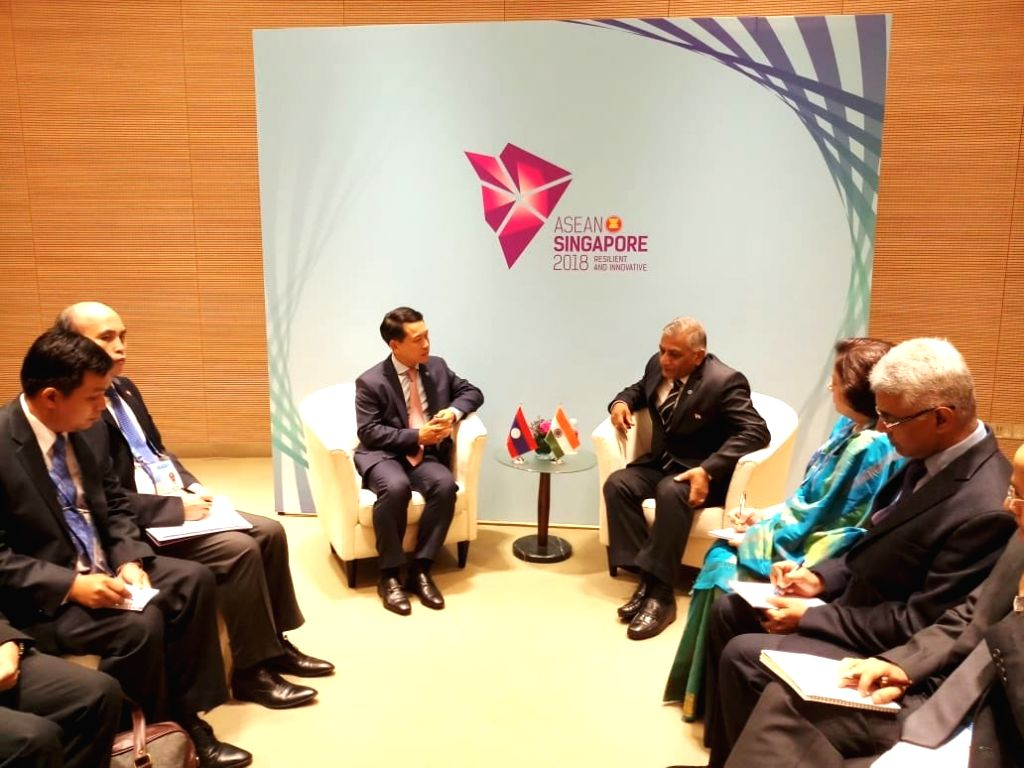 Union MoS External Affairs V.K. Singh meets Lao PDR Foreign Minister Saleumxay Kommasith, in Singapore, on  Aug 3, 2018 - Saleumxay Kommasith and K. Singh