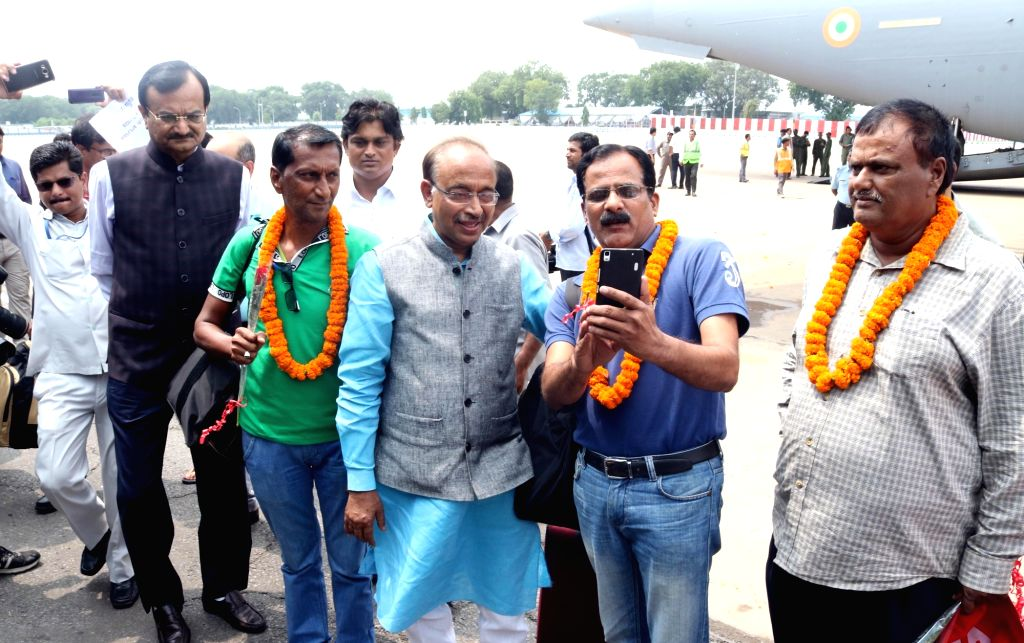 Union MoS External Affairs VK Singh along with the Indians who were evacuated from violence hit South Sudan arrive at Palam Airport in New Delhi; on July 15, 2016. The evacuation was part ...