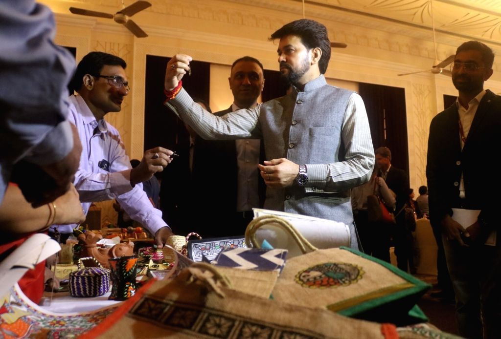 Union MoS Finance and Corporate Affairs Anurag Thakur checks out various handicrafts on display that will be now available on Flipkart in the presence of its CEO Kalyan Krishnamurthy at ...