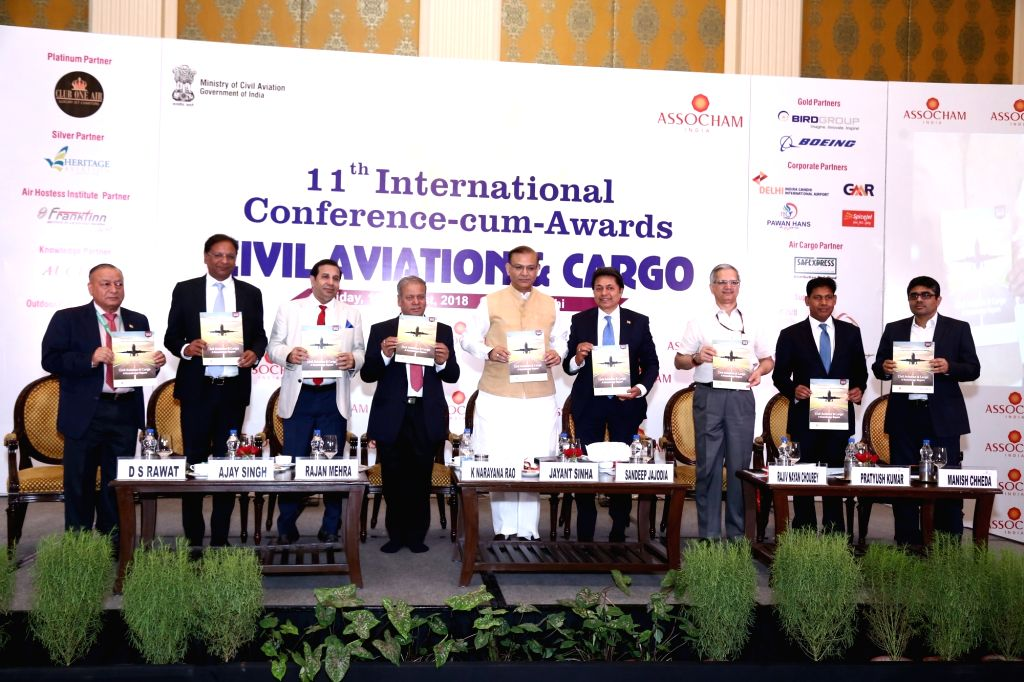 Union MoS for Civil Aviation Jayant Sinha releasing the Conference Background Paper during the ASSOCHAM 11th International Conference-cum-Awards on Civil Aviation in New Delhi on Aug 10, ... - Aviation Jayant Sinha, Ajay Singh, Narayana Rao and Pratyush Kumar