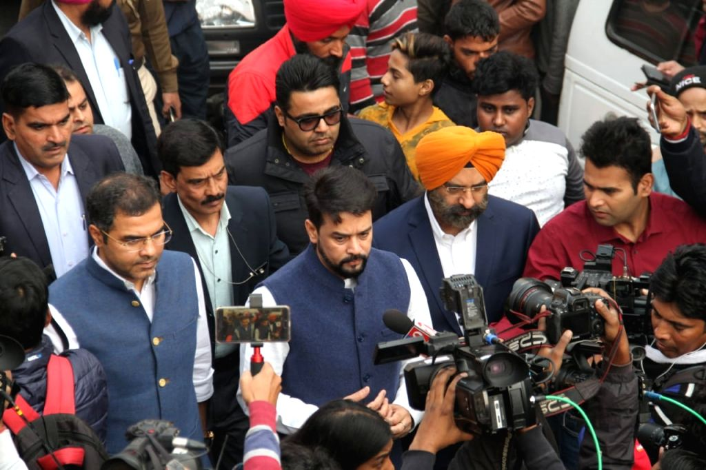 Union MoS for Finance Anurag Singh Thakur talks to press after visiting the factory area in the Anaj Mandi area of Delhi's Rani Jhansi Road area where fire broke out, in Delhi on Dec 8, ... - Anurag Singh Thakur