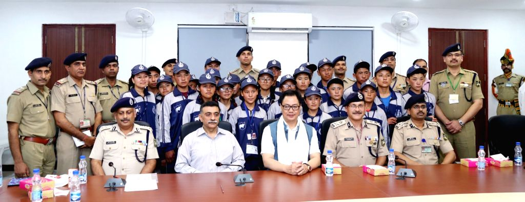 Union MoS for Home Affairs Kiren Rijiju with a group of students from Leh, Jammu and Kashmir attending the National Integration Tour, organised by the 24th Battalion of ITBP in New Delhi ...