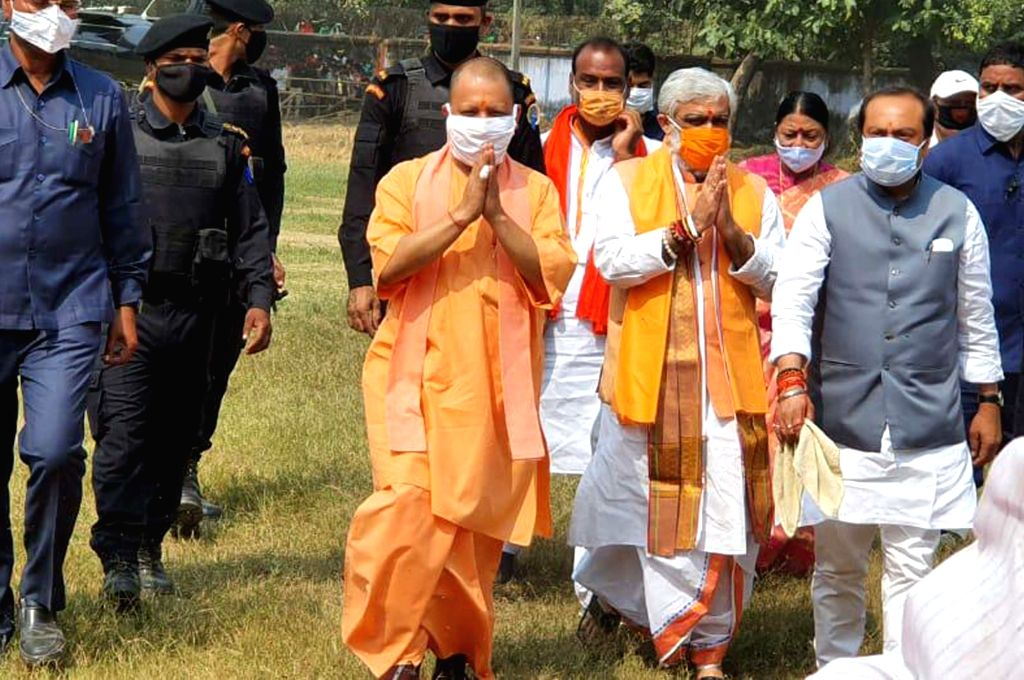 Union MoS Health and Family Welfare Ashwini Kumar Choubey and Uttar Pradesh Chief Minister Yogi Adityanath arrive at an election meeting ahead of Bihar Assembly elections, in Bhabhua on Oct ... - Yogi Adityanath