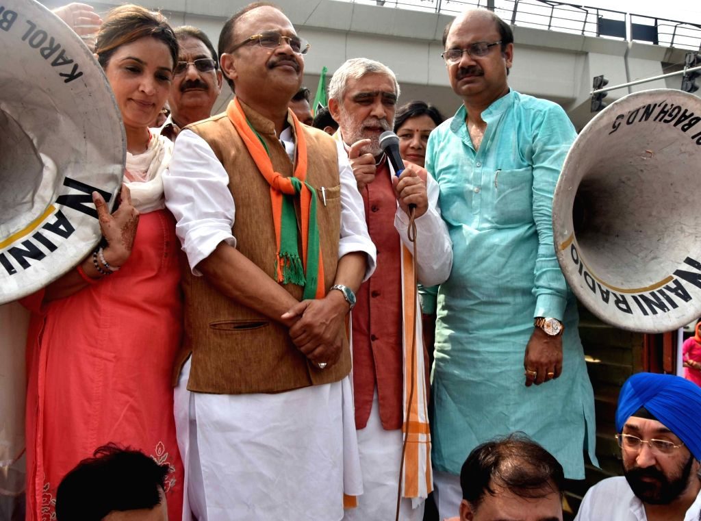Union MoS Health and Family Welfare Ashwini Kumar Choubey along with other BJP leaders participates in 'Jan Raksha Yatra' in New Delhi on Oct 10, 2017.