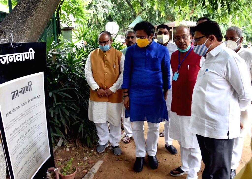 Union MoS Home Affairs G. Kishan Reddy, BJP MP Vjay Goel, party's senior Vice President Shyam Jaju and party's Delhi unit president Adesh Gupta at the inauguration of an exhibition ... - Indira Gandhi, Shyam Jaju and Adesh Gupta