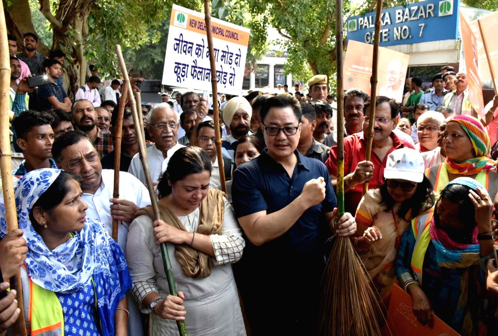 Union MoS Home Affairs Kiren Rijiju  and BJP MP Meenakashi Lekhi participate in a cleanliness drive organised as part of the 'Swachhata Hi Seva Movement', in New Delhi on Sept 15, 2018.