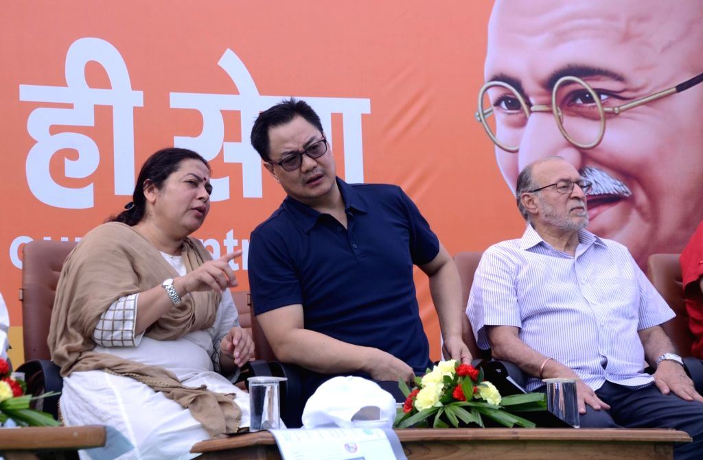 Union MoS Home Affairs Kiren Rijiju in a conversation with BJP MP Meenakashi Lekhi during a a cleanliness drive organised as part of the 'Swachhata Hi Seva Movement', in New Delhi on Sept ...