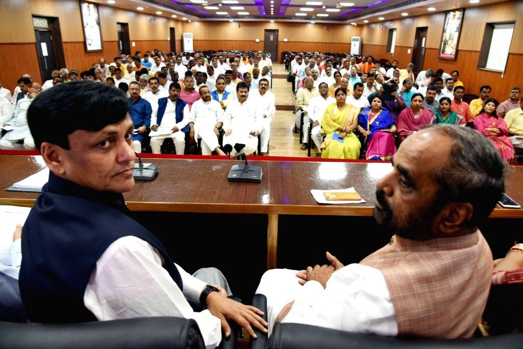 Union MoS Home Affairs Nityanand Rai and Former MoS Home Affairs Hansraj Gangaram Ahir during a BJP meeting at Bihar party headquarters, in Patna on Aug 28, 2019. - Affairs Nityanand Rai