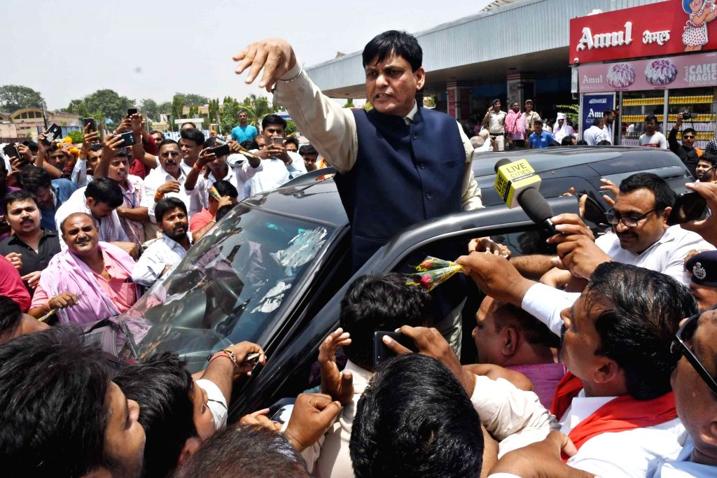 Union MoS Home and Ujiarpur BJP MP, Nityanand Rai receives a warm welcome from supporters on his arrival at the Jay Prakash Narayan International Airport in Patna, on June 15, 2019. - Nityanand Rai