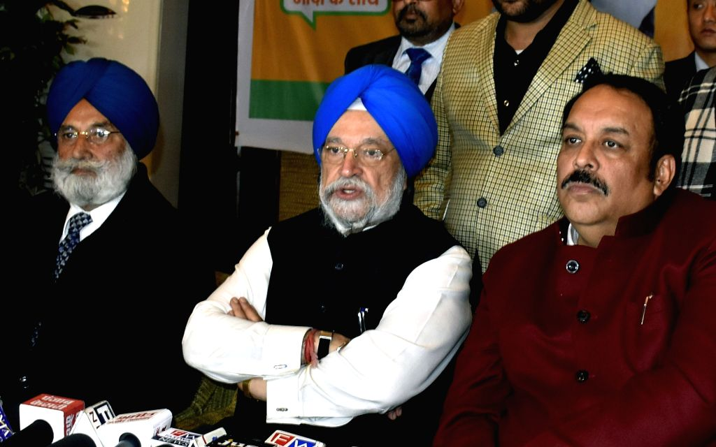 Union MoS Housing and Urban Affairs and BJP leader Hardeep Singh Puri, Punjab BJP President Shawet Malik and party leader Rajinder Mohan Singh Chhina during a press conference in Amritsar ... - Malik and Hardeep Singh Puri