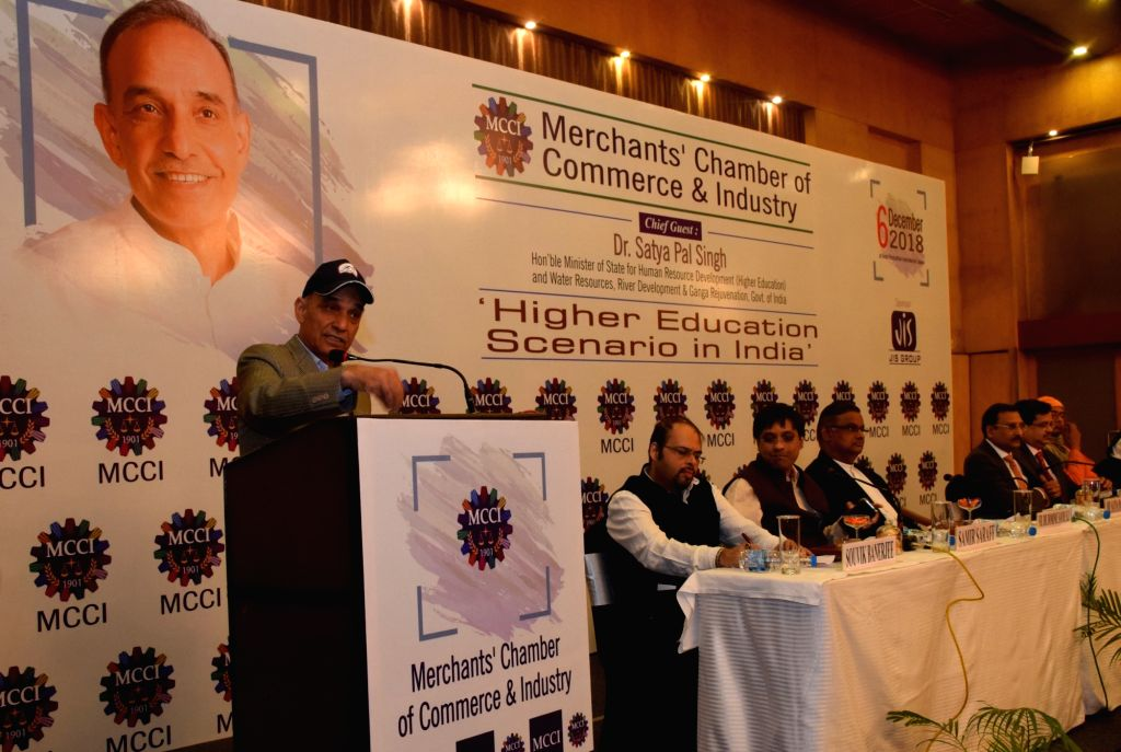 """Union MoS Human Resource Development Satya Pal Singh addresses during a special session on """"Higher Education Scenario in India"""" organised by Merchants' Chamber of Commerce and ..."""