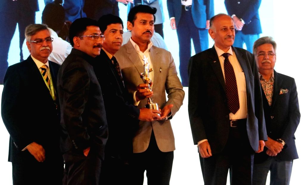 "Union MoS Information and Broadcasting Rajyavardhan Singh Rathore with Hero Corporate Service Pvt Ltd Chairman Sunil Kant Munjal and Hero MotoCorp CMD Pawan Munjal during ""Mindmine ... - Rajyavardhan Singh Rathore"