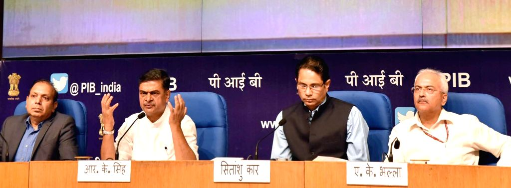 Union MoS Power and New and Renewable Energy Raj Kumar Singh addresses a press conference on four-year achievements of the Ministry of Power and New and Renewable Energy, in New Delhi on ... - Anand Kumar