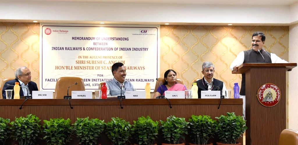 Union MoS Railways Suresh Angadi addresses during the signing of an MoU between the Ministry of Railways and Confederation on Indian Industry (CII) for facilitation of green initiatives in ...