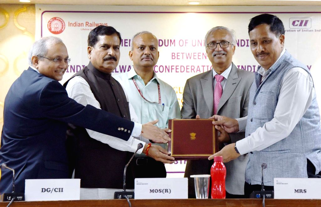 Union MoS Railways Suresh Angadi witnesses the signing ceremony of a Memorandum of Understanding (MoU) between the Ministry of Railways and Confederation on Indian Industry (CII) for ...