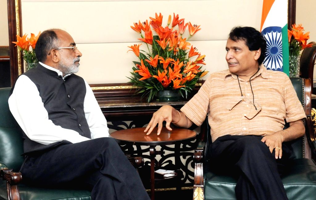 Union MoS Tourism Alphons Kannanthanam meets Union Commerce and Industry and Civil Aviation Minister Suresh Prabhakar Prabhu, in New Delhi on July 24, 2018. - Suresh Prabhakar Prabhu