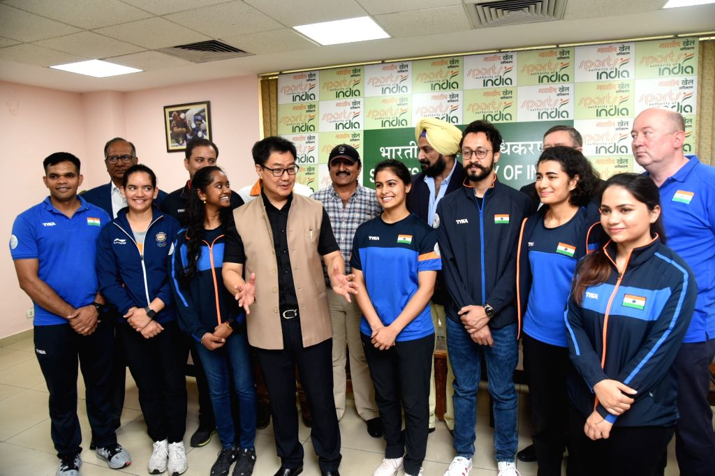 Union MoS Youth Affairs and Sports (Independent Charge) and Minority Affairs Kiren Rijiju interacts with the medal winning Indian shooting team which participated in the ISSF Rifle and ...