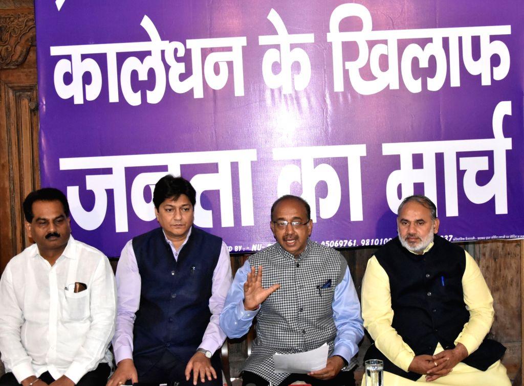 "Union MoS Youth Affairs and Sports Vijay Goel addresses a press conference regarding ""Run for Demonetization"" in New Delhi on Nov 24, 2016."