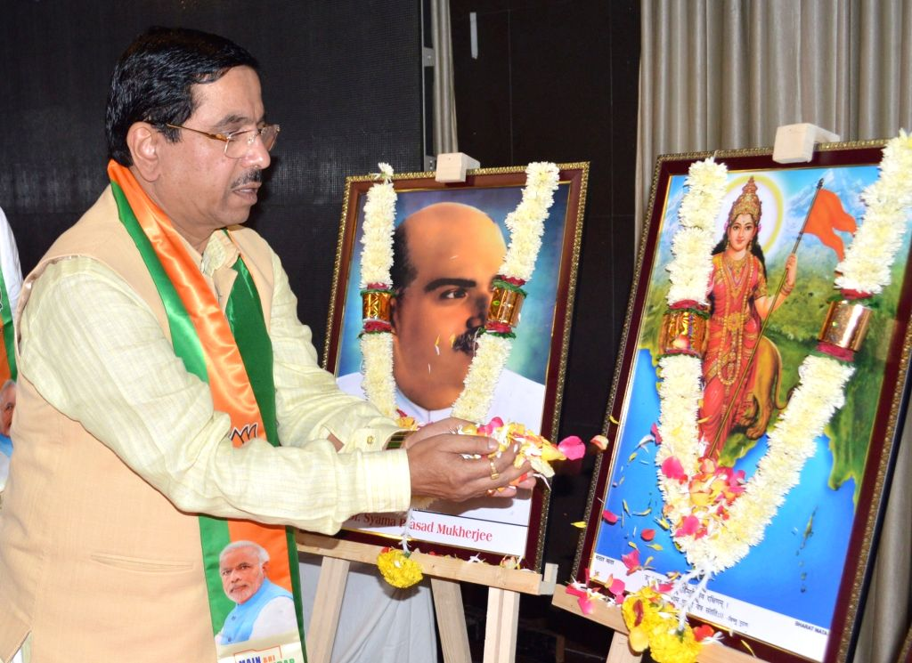 "Union Parliamentary Affairs and Coals and Mines Minister Pralhad Joshi pays tributes to Syama Prasad Mukherjee during ""Jana Jagaran Sabha"" organised on the abrogation of article ... - Pralhad Joshi and Syama Prasad Mukherjee"
