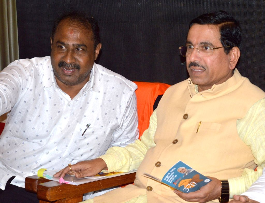 "Union Parliamentary Affairs and Coals and Mines Minister Pralhad Joshi and BJP leader Satish Reddy during ""Jana Jagaran Sabha"" organised on the abrogation of article 370, in ... - Pralhad Joshi and Satish Reddy"