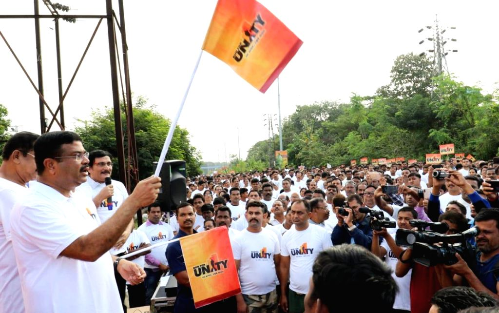 Union Petroleum and Natural Gas and Skill Development and Entrepreneurship Minister Dharmendra Pradhan flags off the 'Run for Unity' Marathon on the birth anniversary of the ... - Dharmendra Pradhan and Sardar Vallabhbhai Patel