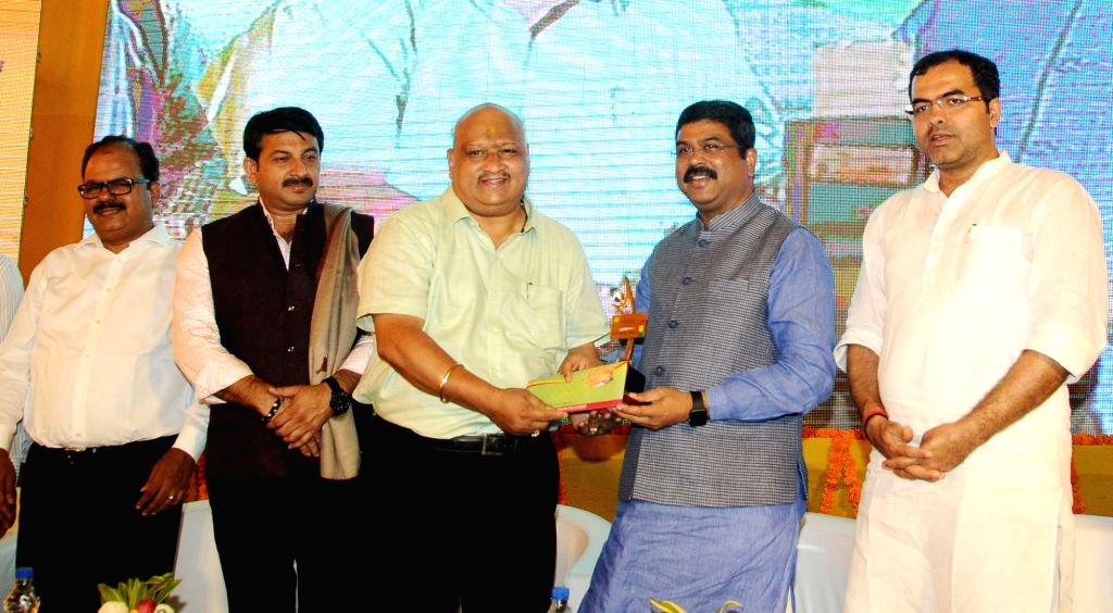 Union Petroleum Minister Dharmendra Pradhan at the launch of IGL smart card, prepaid CNG cards for both retail and fleet customers in New Delhi on Oct 11, 2017. Also seen BJP MP Manoj ... - Dharmendra Pradhan