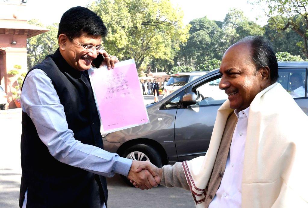 Union Power Minister Piyush Goel shakes hands with Congress leader AK Antony at Parliament in New Delhi on Nov 28, 2016. - Piyush Goel