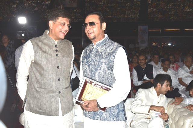Union Power Minister Piyush Goel with actor Gulshan Grover during inauguration of  world's largest MUN Youth Conference at NSCI Stadium in Mumbai on April 10, 2016. - Piyush Goel and Gulshan Grover