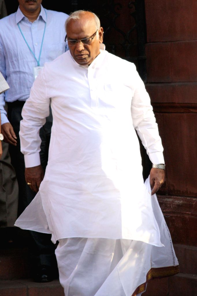 Union Railway Minister Mallikarjun Kharge comes out after the last cabinet meeting of UPA-II government in New Delhi on May 13, 2014. - Mallikarjun Kharge