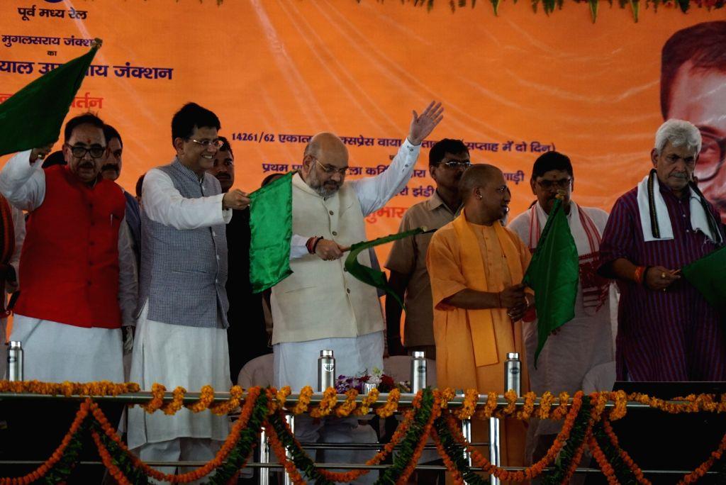 Union Railway Minister Piyush Goyal, Uttar Pradesh Chief Minister Yogi Adityanath and BJP chief Amit Shah during a programme organised to rechristen Mughalsarai Junction as Deen Dayal ... - Piyush Goyal and Amit Shah