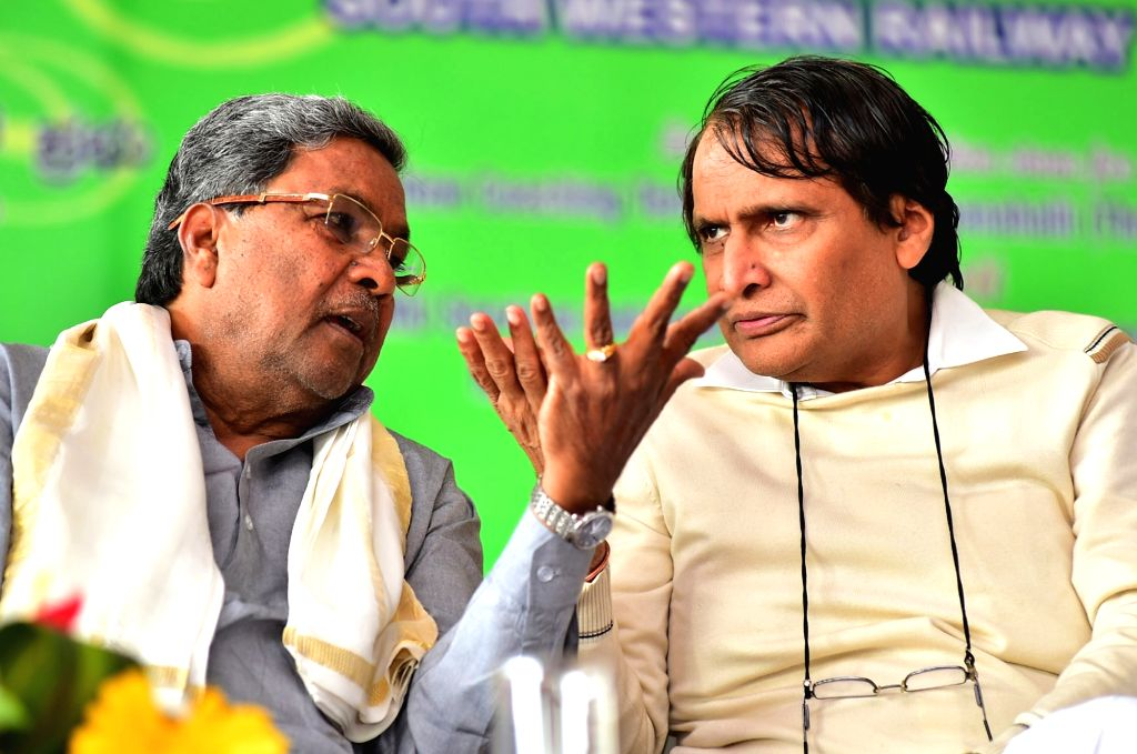 Union Railway Minister Suresh Prabhu and Karnataka Chief Minister Siddaramaiah during a programme organsied to lay the foundation stone for new coaching terminal at Baiyyappanahalli and ... - Suresh Prabhu