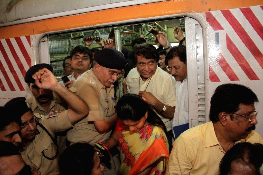 Union Railway Minister Suresh Prabhu travels in Mumbai suburban train  on April 21, 2016. - Suresh Prabhu