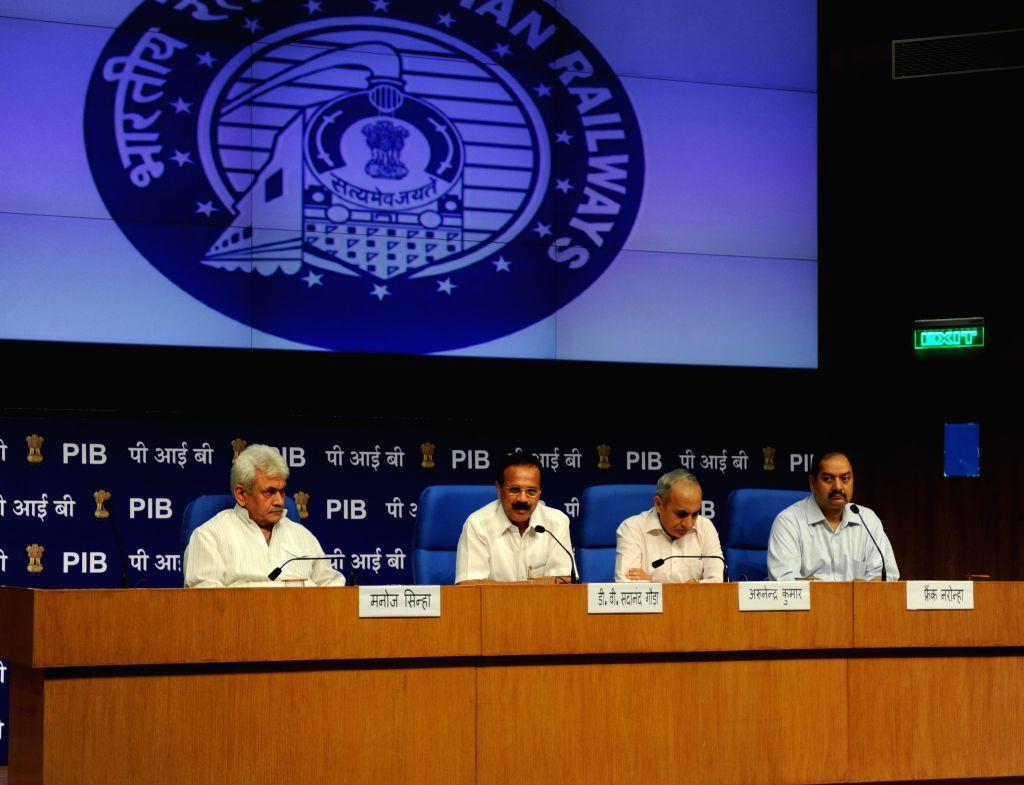 Union Railway Minster Sadananda Gowda and MoS Railways Manoj Sinha during a press conference in New Delhi on Sept 8, 2014. - Manoj Sinha
